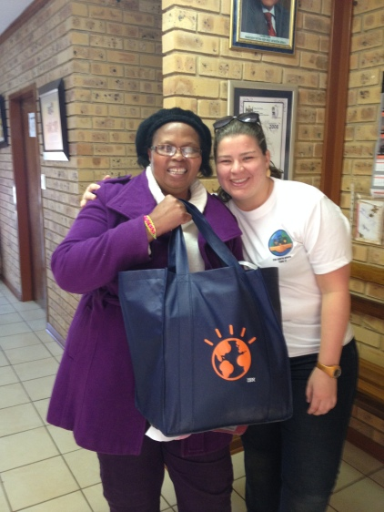 Donating supplies to the principal of the Bophelong school