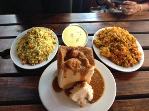 Bunny Chow in the middles, flanked with Butter Chicken and Vegetable Biryani (I think?)